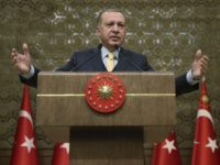 "Turkey's President Recep Tayyip Erdogan addresses local administrators in Ankara, Turkey, Wednesday, Jan. 24, 2018. Erdogan says Turkey's incursion into a Kurdish-held enclave in Syria is progressing ""successfully"" and will continue until the last ""terrorist"" is eliminated. (Murat Cetinmuhurdar/Pool Photo via AP)"