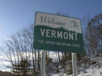 This Friday, Jan. 26, 2018, photo shows a road sign welcoming drivers to Vermont in Wells River, Vt., on the New Hampshire border. Vermont officials are hoping a new program that would use cutting-edge, targeted marketing and a host of incentives, both economic and emotional, can attract new people to …