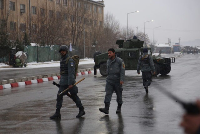 Afghan security personnel arrive at the site of an attack at the Marshal Fahim academy in Kabul, Afghanistan Monday, Jan. 29, 2018. An Afghan official and an eyewitness say blasts have been heard and a gunbattle is occurring near the military academy in the capital Kabul. (AP Photo/Rahmat Gul)