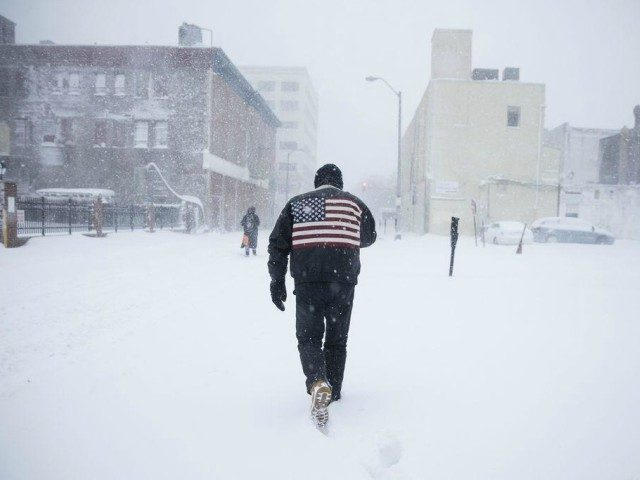 A man pushes his way through a winter snowstorm in Atlantic City, N.J., Thursday, Jan. 4, 2018. A massive winter storm swept from the Carolinas to Maine on Thursday, dumping snow along the coast and bringing strong winds that will usher in possible record-breaking cold. (AP Photo/Matt Rourke)