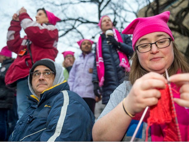 WASHINGTON, DISTRICT OF COLUMBIA - JANUARY 21: Emily Crowley from Vermont knits a pink hat for protesters at the Women's March on Washington on January 21, 2017 in Washington, DC. (Photo by Ann Hermes/The Christian Science Monitor via Getty Images)
