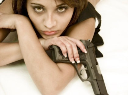 A woman holding a pistol