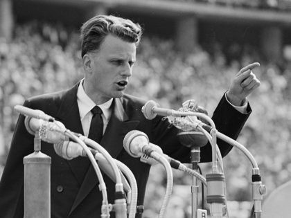 American evangelist Billy Graham speaks to over 100,000 Berliners at the Olympic Stadium in Germany, June 27, 1954. (AP Photo)
