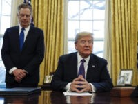 "President Donald Trump, joined by U.S. Trade Representative Robert Lighthizer, left, waits for members of the media to take their places before signing Section 201 actions in the Oval Office of the White House in Washington, Tuesday, Jan. 23, 2018. Trump says he is imposing new tariffs to ""protect American …"