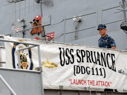 US Navy's Pacific Fleet commander Admiral Harry Harris leaves after visiting the USS Spruance (DDG 111), Arleigh Burke-class guided-missile destroyer (background) which docked in Sembawang wharves in Singapore on January 22, 2014. Admiral Harris, the US Navy's most senior officer in the Pacific region, identified North Korea as its 'number …