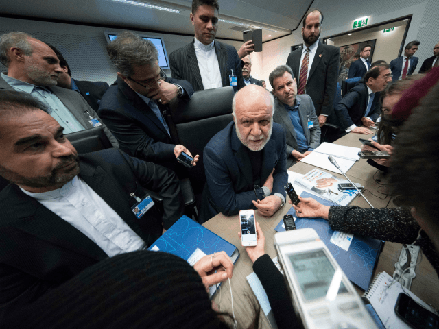 Iran's Oil Minister Bijan Namdar Zanganeh (C) speaks to journalists as he attends the 173rd OPEC Conference of Organization of the Petroleum Exporting Countries (OPEC) in Vienna, on November 30, 2017. ?The OPEC will discuss a possible extension beyond March of its pact with Russia and other major oil producers …