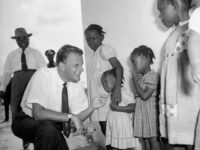Evangelist Billy Graham meets children during a visit to a missionary institute Jan. 20, 1960, in Virginia, Liberia. Royale via AP