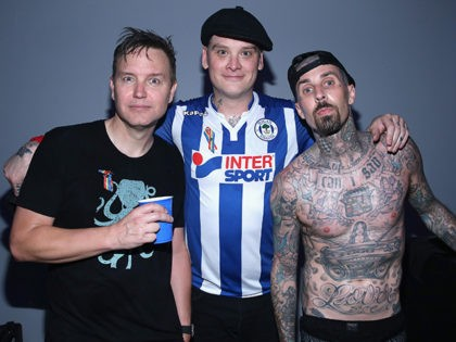 LOS ANGELES, CA - JUNE 12: (L-R) Musicians Mark Hoppus, Matt Skiba and Travis Barker of Blink-182 backstage as Bethesda Softworks shows off new video game experiences at its E3 Showcase and BE3 Plus event at the LA Hangar in Los Angeles, ahead of the Electronic Entertainment Expo (E3) happening …