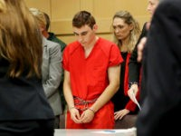 Nikolas Cruz appears in court for a status hearing before Broward Circuit Judge Elizabeth Scherer on Monday, Feb. 19, 2018. Cruz is facing 17 charges of premeditated murder in the mass shooting at Marjory Stoneman Douglas High School in Parkland, Fla. (Mike Stocker/Sun Sentinel/TNS via Getty Images)
