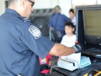 A CBP officer processes arriving bus passengers at Laredo Port of Entry.