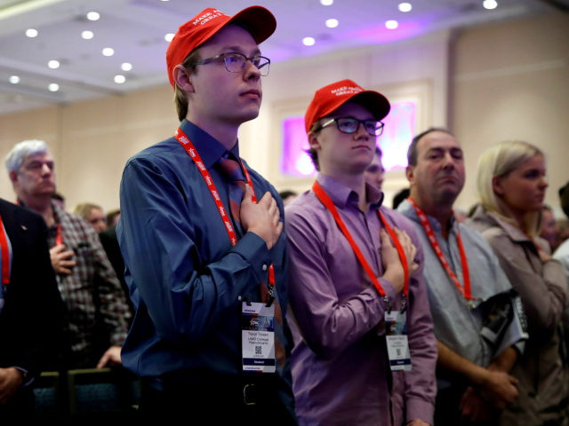 Trevor Tovsen, center, with the University of Maryland College Republicans, says the Pledge of Allegiance, during the Conservative Political Action Conference (CPAC), at National Harbor, Md., Friday, Feb. 23, 2018, where President Donald Trump is expected to speak. (AP Photo/Jacquelyn Martin)