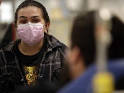 California flu (Gregory Bull / Associated Press)