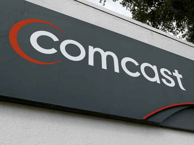 POMPANO BEACH, FL - FEBRUARY 13: A Comcast sign is seen at one of their centers on February 13, 2014 in Pompano Beach, Florida. Today, Comcast announced a $45-billion offer for Time Warner Cable. (Photo by Joe Raedle/Getty Images)
