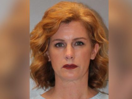 Dawn Diimmler, 44, a former assistant principal at Airport High School, turned herself in to police Saturday morning and was charged with sexual battery of a student for alleged sexual encounters with a student, the State reported.
