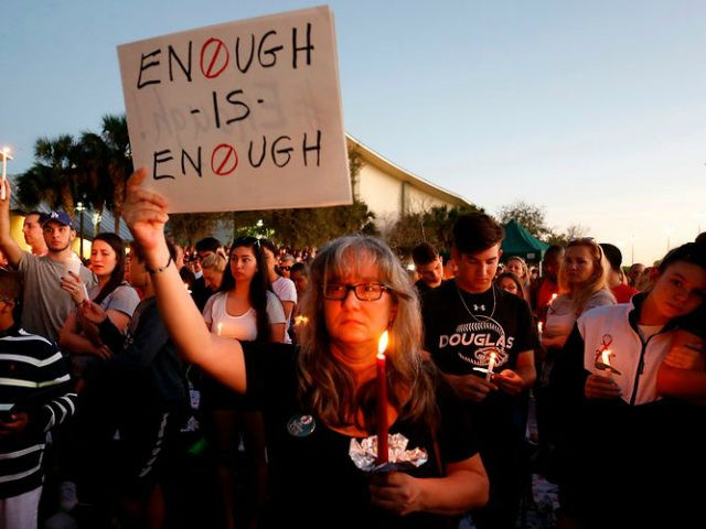 A demonstrator demands action against gun violence during a vigil held for the 17 people killed in the Parkland high school shooting