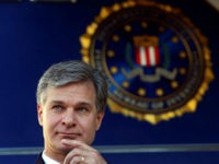 F.B.I director Christopher Wray is shown before speaking to reporters during a dedication ceremony for the new Atlanta Field Office building Thursday, Oct. 12, 2017, in Atlanta, (AP Photo/John Bazemore)