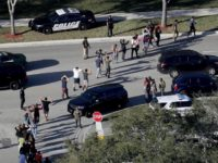 Students being led from are brought out of the Marjory Stoneman Douglas High School following shooting that killed 17 students. AP Photo: Mike Stocker