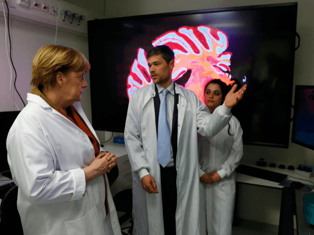 German Chancellor Angela Merkel, doctor Hans Fried and Eleonora Ambrad talk inside the new research center for dementia diseases DZNE at the university hospital in Bonn, Germany, on March 15, 2017.