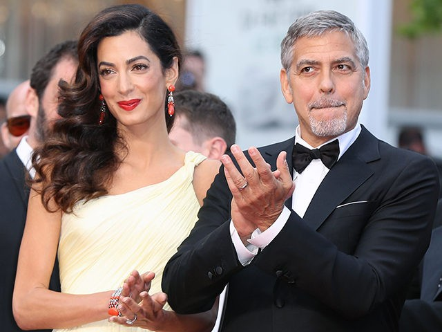 TOPSHOT - US actor George Clooney (R)and his wife British-Lebanese lawyer Amal Clooney arrive on May 12, 2016 for the screening of the film 'Money Monster' at the 69th Cannes Film Festival in Cannes, southern France / AFP PHOTO / Valery HACHE (Photo credit should read VALERY HACHE/AFP/Getty Images)