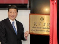 China's Vice President Xi Jinping unveils the plaque at the opening of Australia's first Chinese Medicine Confucius Institute at the RMIT University in Melbourne on June 20, 2010. The Confucius Institute will promote the study of Chinese culture and language with a focus on Chinese Medicine - one of the …