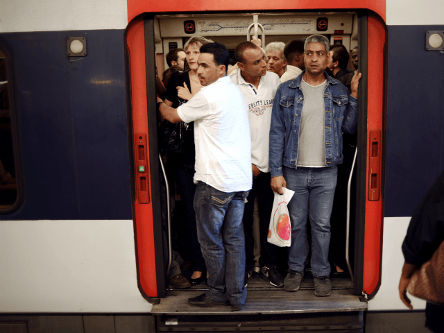 Commuters wait for the departure of a RER regional train at the Denfert-Rochereau station in Paris on June 24, 2010 as a mass strike against the French government's plan to raise the retirement age disrupted transport. The bill raising the retirement age from 60 to 62 is due to be …