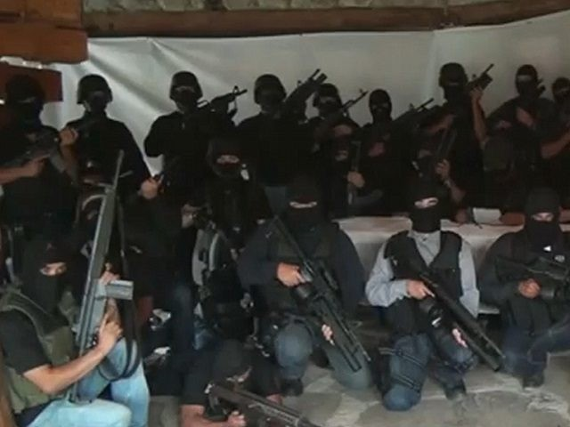 "Screen capture of a paramilitary group which vowed to ""eliminate"" the Zetas, reputedly Mexico's most violent drug gang, in a video posted on the Internet on July 27, 2011 several days after 49 bodies were found on the streets of Veracruz. The video, according to its creators, shows a group …"
