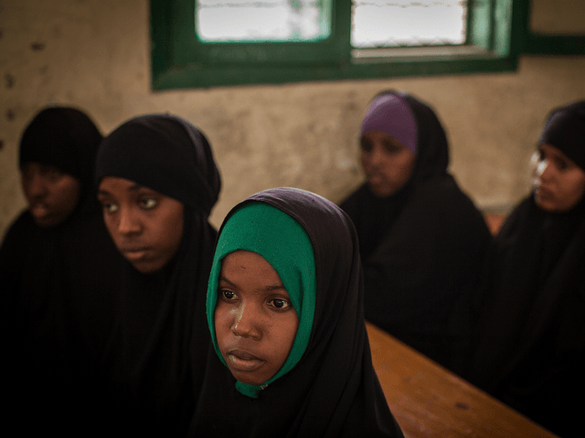 TO GO WITH AFP STORY BY HELEN VESPERINI Women take part with other young women and men in a discussion on female genital mutilation (FGM) at an after school program for children's rights at Sheikh Nuur primary school in Hargeysa on February 19, 2014. The centuries old tradition of female …