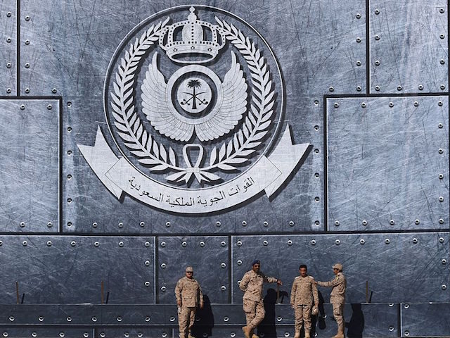 TOPSHOT - Army officers stand under the Saudi Air Force logo during a ceremony marking the 50th anniversary of the creation of the King Faisal Air Academy at King Salman airbase in Riyadh on January 25, 2017. / AFP / FAYEZ NURELDINE (Photo credit should read FAYEZ NURELDINE/AFP/Getty Images)