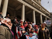 NEW YORK, NY - FEBRUARY 01: Women wear American Flag head scarfs at an event at City Hall for World Hijab Day on February 1, 2017 in New York City. The day was started five years ago when a Muslim in New York invited other women to experience what it …