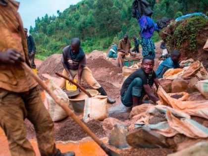 """People work at the Kalimbi cassiterite artisanal mining site north of Bukavu, in Democratic Republic of Congo, on March 30, 2017. In the lush hills of eastern DR Congo, where the trade in rare minerals has long fed unrest, miners complain that recent US rules against """"conflict minerals"""" have bitten …"""