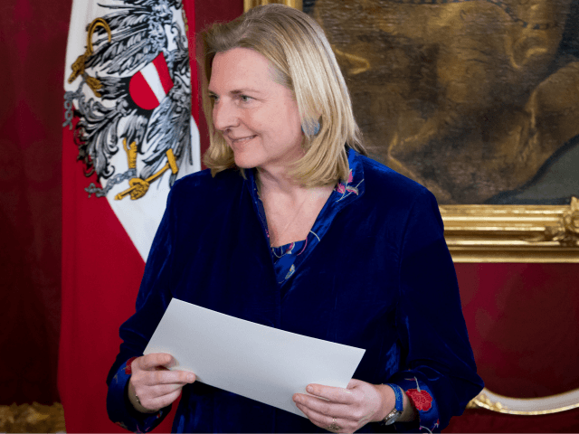 Austrian Foreign minister Karin Kneissl holds her letter of appointment during the inauguration ceremony of the new Austrian government at the Hofburg in Vienna, Austria, on December 18, 2017. Austria's president swore in Sebastian Kurz as head of a new coalition government involving Kurz's conservatives and the far-right, capping a …