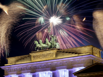 Fireworks explode over the Brandenburg Gate during New Year's festivities on January 1, 2018 in Berlin, Germany.