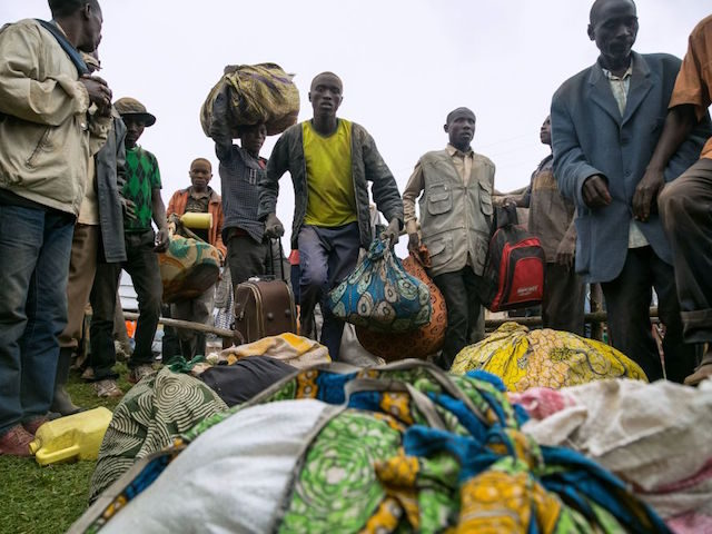Congolese people who crossed the border from the Democratic Republic of Congo arrive at the Nyakabande transit centre in the village of Nyakabande, western Uganda, to be registered as refugees on January 24, 2018. Since Last December, Congolese people, about 300 people per day, have been fleeing from the Mai …