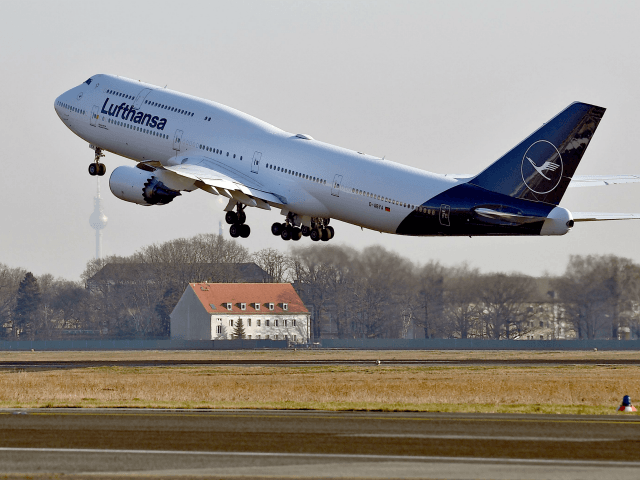 A Boeing 747-8 displaying the new logo of the German airline Lufthansa takes off at the Airport Tegel in Berlin on February 8, 2018. / AFP PHOTO / dpa / Britta Pedersen / Germany OUT (Photo credit should read BRITTA PEDERSEN/AFP/Getty Images)