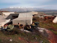 A picture taken on February 10, 2018 show Israeli solders taking positions in the Israeli-occupied Golan Heights near the border with Syria. Syrian air defences repelled an Israeli raid on a military base in the centre of the country, hitting more than one warplane, state media said. The report came …