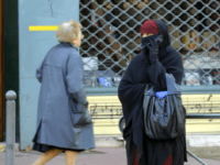 A woman wearing a niqab, the islamic full veil, gives a phone call in a street of Lyon, eastern France, on January 25, 2010. A ban on the wearing of the full Islamic veil is being studied in several European countries, including the Netherlands, Denmark and Austria. In France a parliamentary commission is due to present a much-awaited report on January 26, 2010, which is expected to recommend that new legislation be enacted to ban the full veil, known as the burqa or niqab, in public places. AFP PHOTO/PHILIPPE DESMAZES (Photo credit should read PHILIPPE DESMAZES/AFP/Getty Images)