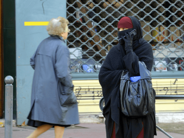 A woman wearing a niqab, the islamic full veil, gives a phone call in a street of Lyon, eastern France, on January 25, 2010. A ban on the wearing of the full Islamic veil is being studied in several European countries, including the Netherlands, Denmark and Austria. In France a …