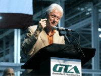 In this July 6, 2012 photograph, former President Bill Clinton speaks during the unveiling of GreenTech Automotive's new electric MyCar at their manufacturing facility in Horn Lake, Miss. (AP Photo/Rogelio V. Solis)
