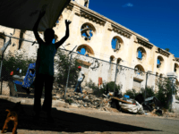 PORT-AU-PRINCE, HAITI - FEBRUARY 10: A child stands in front of a destroyed church in Port au Prince on February 10, 2018 in Port-au-Prince, Haiti. Haiti, the poorest country in the Western Hemisphere, is still reeling from President Donald Trump's comments about the Caribbean nation and his decision to revoke Temporary Protected Status (TPS) for Haitians living in America following the 2010 earthquake that claimed over 300,000 lives. Haiti is currently preparing for the start of Carnival on Sunday. (Photo by Spencer Platt/Getty Images)