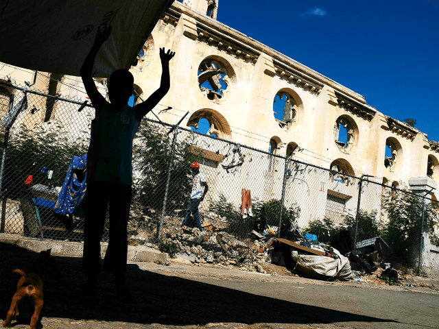 PORT-AU-PRINCE, HAITI - FEBRUARY 10: A child stands in front of a destroyed church in Port au Prince on February 10, 2018 in Port-au-Prince, Haiti. Haiti, the poorest country in the Western Hemisphere, is still reeling from President Donald Trump's comments about the Caribbean nation and his decision to revoke …