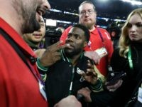 Comedian and Philidelphia native Kevin Hart attempts to get onto the stage following the Eagles 41-33 win over the New England Patriots in Super Bowl LII at U.S. Bank Stadium on February 4, 2018 in Minneapolis, Minnesota. (Photo by Elsa/Getty Images)