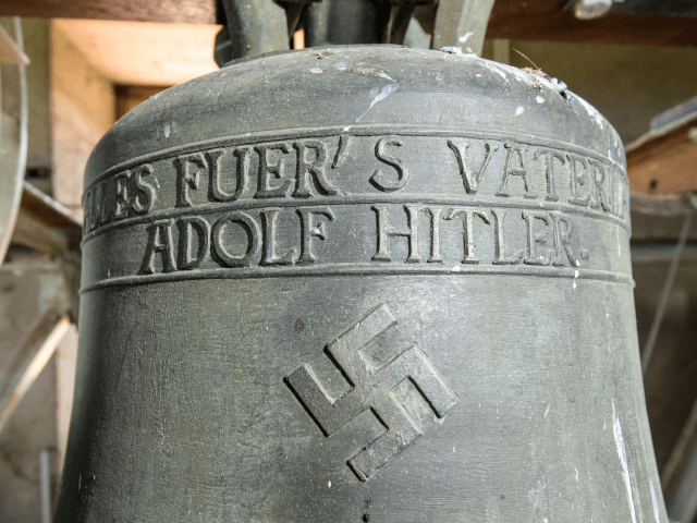 The church bell embossed with a swastika and the text: 'Everything for the Fatherland Adolf Hitler' in the Jakobskirche village church pictured on June 13, 2017 in Herxheim, Germany. For 82 years the 1930s-era church bell, cast when Germany was ruled by Adolf Hitler, hung in the 1,000-year-old church tower …