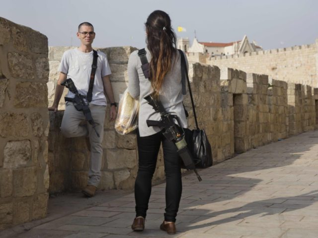 Israeli woman with rifle (Oded Balilty / Associated Press)