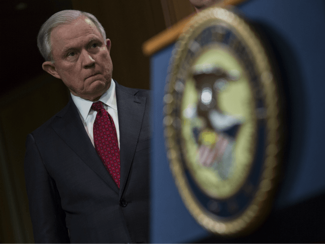 Attorney General Jeff Sessions listens during a press conference at the Department of Justice in Washington, DC on February 27, 2018. Sessions introduced the Prescription Interdiction Litigation task force (PILS), aimed to combat the opiod epidemic. (Photo by Toya Sarno Jordan/Getty Images)