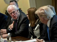 Senate Majority Whip John Cornyn, a Republican from Texas, center left, speaks while U.S. President Donald Trump, right, listens during a meeting with bipartisan members of Congress on immigration in the Cabinet Room of the White House in Washington, D.C., U.S., on Tuesday, Jan. 9, 2018. Trump indicated he's willing to …