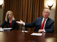 Secretary of Homeland Security Kirstjen Nielsen listens as President Donald Trump speaks during a meeting with law enforcement officials on the MS-13 street gang and border security, in the Cabinet Room of the White House, Tuesday, Feb. 6, 2018, in Washington. (AP Photo/Evan Vucci)