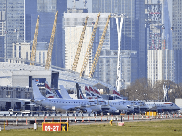 Planes on the apron at London City Airport which has been closed after the discovery of an unexploded Second World War bomb was found in the nearby River Thames, Monday Feb. 12, 2018. (Dominic Lipinski/PA via AP)