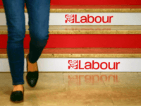 A woman walks down the stairs at a conference centre hosting the Labour party Conference in Brighton, south England on September 23, 2017. Britain's revitalised Labour opposition kicks off its annual conference on Sunday with leader Jeremy Corbyn set to lay out his party's agenda, free from the leadership challenges …