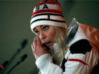 United States' Lindsey Vonn wipes her face while speaking at a press conference after winning the bronze medal in the women's downhill at the 2018 Winter Olympics in Jeongseon, South Korea, Wednesday, Feb. 21, 2018. (AP Photo/Christophe Ena)
