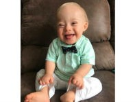 "14-month-old Lucas Warren of Dalton, Ga. won over executives at Gerber baby food who have made him their ""spokesbaby"" this year. Lucas is Gerber's first spokesbaby with Down syndrome in the company's 91-year history. (Courtesy Warren family/Gerber via AP)"